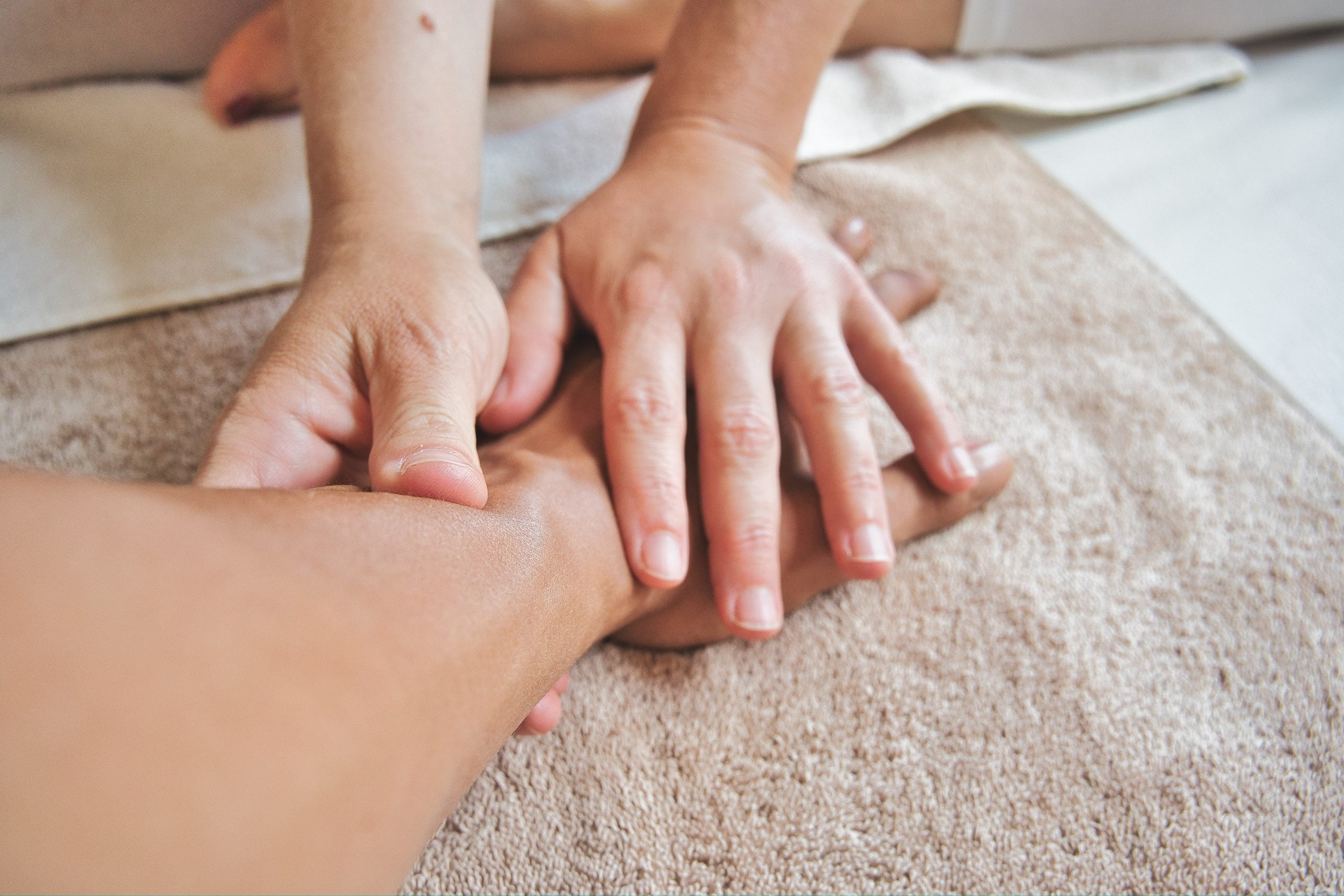 conscious-design-ubeslMfS1lk-unsplash hand massage